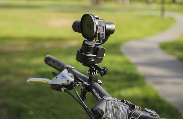 Rider-M and GoPro Hero 4 attached to bike's handle bars